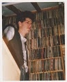 Dirk in the attic with the 7 inch singles at Peel Acres - 1989